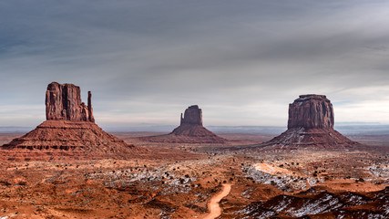 Panorama of 10 images of the majestic monument valley covered in snow