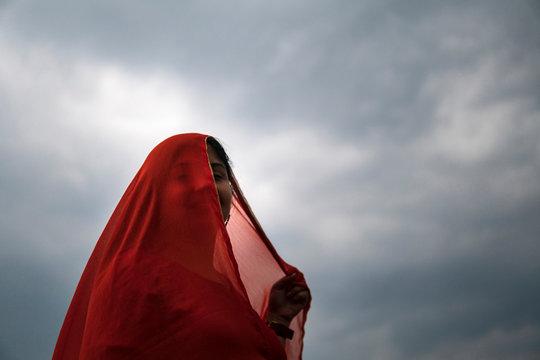 Indian woman enjoying monsoon breeze at outdoors