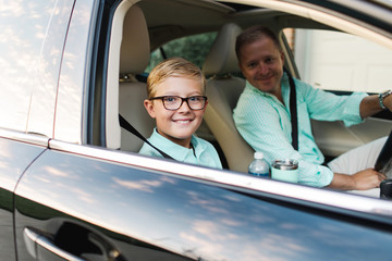 boy and his father on the morning commute to school and work Fototapete