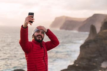 Man with mobile phone on beautiful landscape