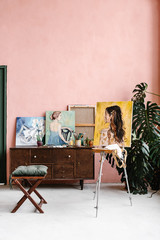Easel with portrait in workshop