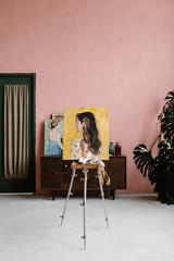 Female portrait on easel in studio