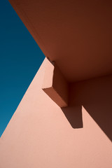 Pink wall details against blue sky