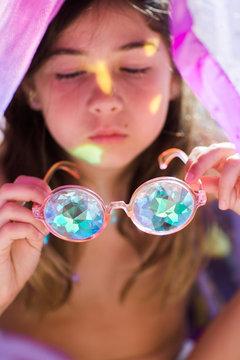 Girl With Purple Kaleidoscopic Glasses