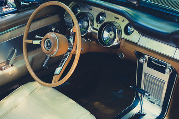 Steering wheel, dashboard and interior of Ford Mustang vintage car cockpit at  Oldtimer  event for vintage cars and  vehicles- Berlin, Germany - June 2018