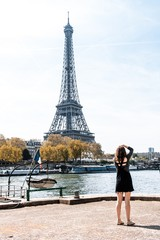 Woman taking a picture of the Eiffel Tower