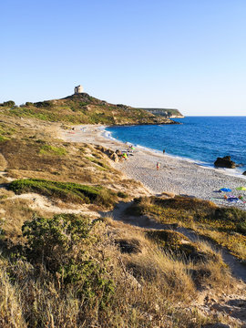 Sunset beach of San Giovanni di Sinis (Sardinia, Italy) and in the background the old tower.