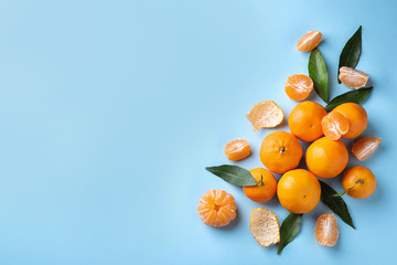 Fototapete - Fresh ripe tangerines on light blue background, flat lay. Space for text