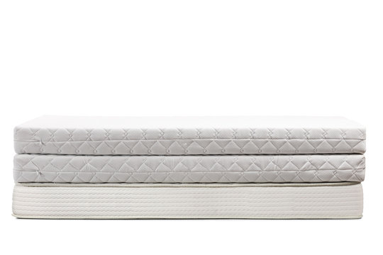 Studio shot of three bed mattresses on top of each other