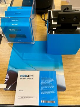 NEW YORK- DECEMBER 30, 2019: Amazon Echo Auto adds Alexa to car connects app on phone and plays car's speakers via auxiliary input. AMZN Jeff Bezos CEO. Virtual assistant Ask music, news, information.