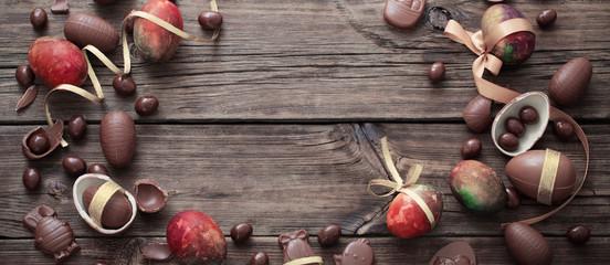 chocolate eggs on dark wooden background