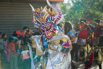 native man defile in colorful costume at dominican traditional carnival annual event