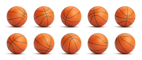 Fototapeta Set of orange basketball balls with leather texture in different positions obraz