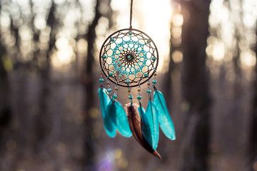 Handmade dream catcher with feathers threads and beads rope hanging Wall mural