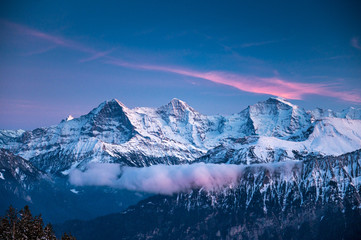 Eiger Mönch and Jungfrau during the blue hour in winter Fototapete