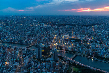 Cityscape of Tokyo from the Skytree at sunset. From the observation deck is possibile to see Asahi building headquarters and Sensoji temple
