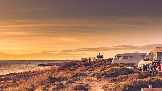 Camper cars on beach sea shore