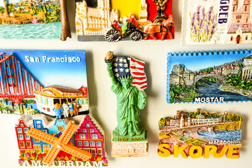 Magnets on refrigerator from travelling - stock photo, souvenir shopping