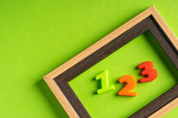 123 and empty photo frame against green background.  Wall mural
