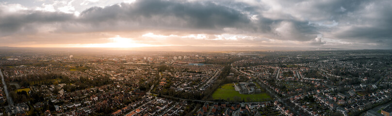 Beautiful Aerial Panorama of Chester at sunset in, Cheshire, UK. Christmas Day December 2019, showing residential buildings and a cloudy sky Fotomurales