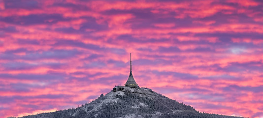Aluminium Prints Candy pink Dramatic Liberec sunset sky with illuminated clouds in the mountains.