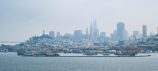 Fototapete - Foggy Coast of San Francisco Across the Harbor from the Bay