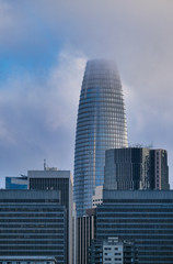 Fotomurales - Modern Tower in San Francisco on Foggy Day