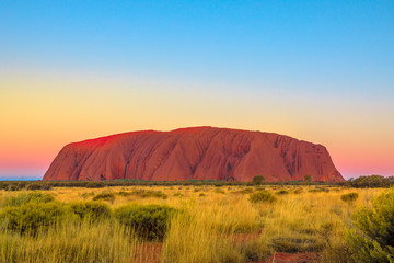 Uluru or Ayers Rock after sunset. The iconic monolith at twilight in Uluru-Kata Tjuta National Park, Australia, Northern Territory. Aboriginal land in Australian outback or Red Centre.