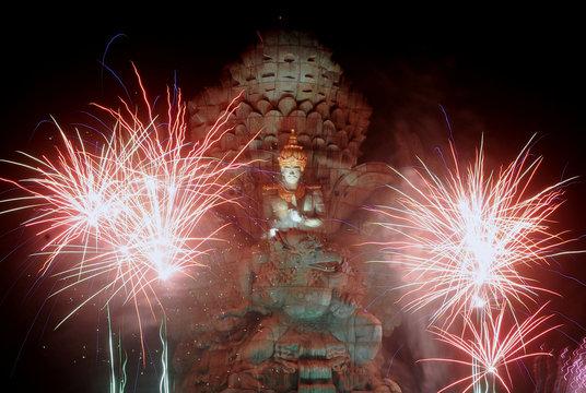 Fireworks explode over Garuda Wisnu Kencana statue during New Year's celebrations in Bali