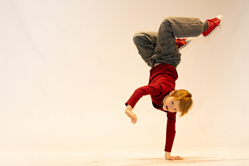 young dancer in breakdance position, child in a unique dance pose