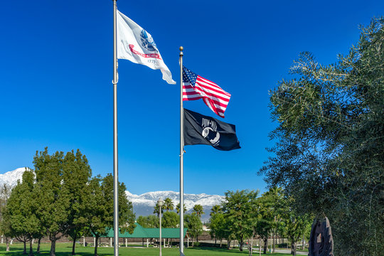 The flags of the United States, POW MIA, and USA Army in Central Park located in Rancho Cucamonga, California on December 28, 2019.