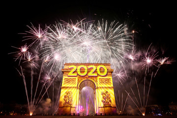 Fireworks illuminate the sky over the Arc de Triomphe during the New Year's celebrations on the Champs Elysees in Paris