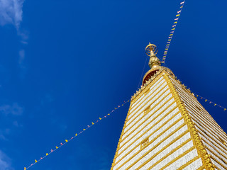 View of Wat Phra That Nong Bua temple during afternoon with blue sky background, Ubon Ratchathani, Thailand
