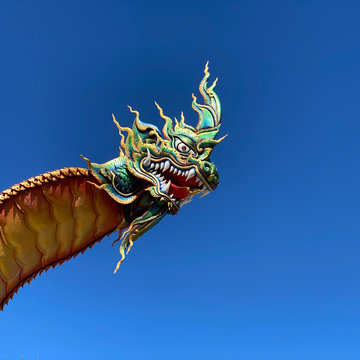 Part of Naga head with blue sky background, Wat Phra That Nong Bua, Ubon Ratchathani, Thailand