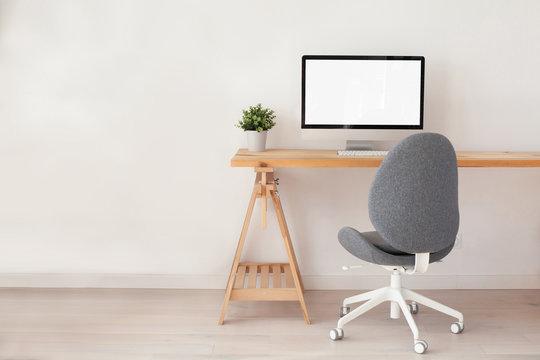 beautiful minimalist workspace interior, computer on wooden table, office workplace, modern scandinavian style design