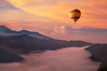 Poster Coral travel on hot air balloon, beautiful inspirational landscape with sunrise colorful sky