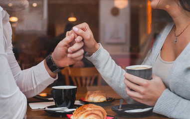 dating, romantic date in restaurant for couple, man and woman holding hands