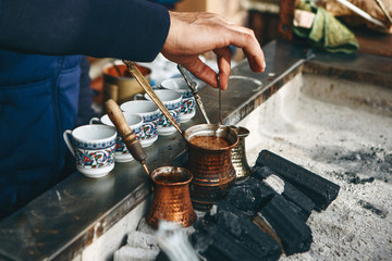 Cooking fresh aromatic traditional Turkish coffee on charcoal. Traditional turkish cuisine. Fototapete
