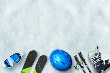 Ski equipment placed on snow. Free space above for text, logo promotion. Winter ski vacation concept. To view, flat lay