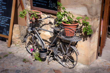 Aluminium Prints Bicycle Vase bicycle in Comillas, Santander.