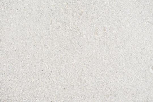 Seamless white sand background. Beach. Close-up