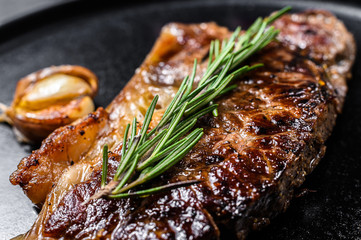 Beef New York strip steak on black background. Space for text. Marble premium beef. Close up. Wall mural