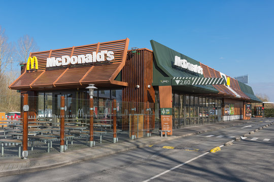 Exterior of modern Mc Donald's fastfood restaurant with drive-thru