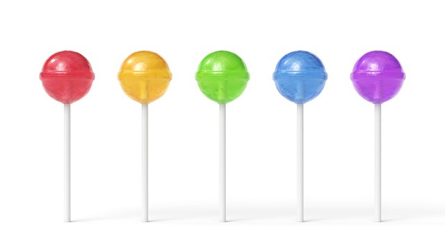 Set of five colorful sweet lollipops isolated on white background
