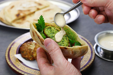 egyptian falafel served in a pita bread with tahini sauce