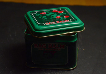 green metal container of bag balm patroleum jelly