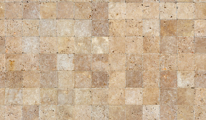 Seamless wall background with Yellow natural sandstone tiles stitched together with clay