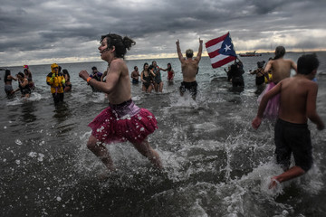 Revelers brave frigid temperatures for the annual Polar Bear plunge at Coney Island