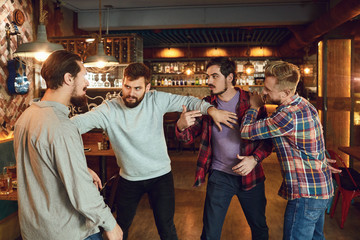 Drunk people are fighting in a pub.
