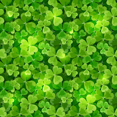 Vector St. Patrick's day seamless background texture with green shamrock leaves.